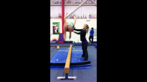 Improper Back Tuck (During) - Note Body Mechanics and  Arms Extended for Spot