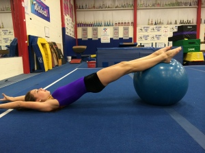 Stability Ball Hamstring Curls  With Arms Overhead- End