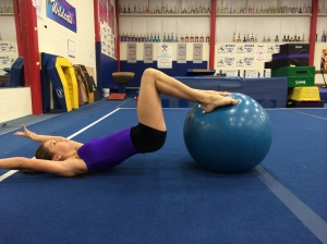 Stability Ball Hamstring Curls with Arms Overhead - End